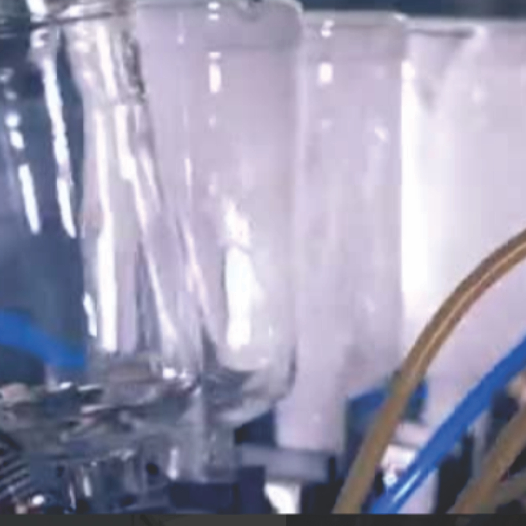 máy súc rửa chai